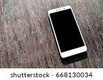 smart phone equipment on a wood ...   Shutterstock . vector #668130034