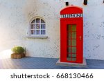 red telephone box vintage in... | Shutterstock . vector #668130466