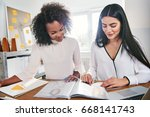 two young women in business... | Shutterstock . vector #668141743