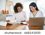 two young women working... | Shutterstock . vector #668141830