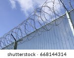 part of a barbwired fence on a... | Shutterstock . vector #668144314
