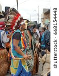 Small photo of COTACACHI, ECUADOR - JUNE 24, 2017: Man in an American Indian costume in the men's parade for Inti Raymi, the indigenous solstice celebration, with a history of violence