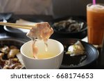 pork in to sauce cheese | Shutterstock . vector #668174653