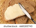 a knife spreading butter on... | Shutterstock . vector #668183743