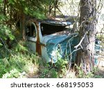 Old Mangled Up Car In The...