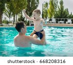 father and son funny in  water... | Shutterstock . vector #668208316