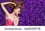 beautiful girl lies in the... | Shutterstock . vector #668209978
