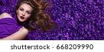 the girl in the petals.... | Shutterstock . vector #668209990