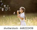 little happy girl with tight... | Shutterstock . vector #668222458
