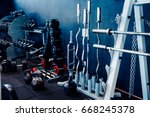 Small photo of Sports equipment of the gym: barbell, rods, disks, weight, neck, dumbbells.