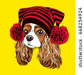 Stock vector portrait of the cavalier king charles spaniel in a knitted cap with pom pom vector illustration 668254924
