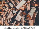 chopped firewood on a stack ...   Shutterstock . vector #668264770