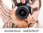 man photograph with camera in... | Shutterstock . vector #668265619