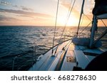sailing yacht at sunset in the... | Shutterstock . vector #668278630