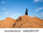 female figure on top of a sand... | Shutterstock . vector #668289199