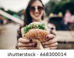 big juicy burger in hand....   Shutterstock . vector #668300014