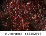 cooking onion caramel sauce on... | Shutterstock . vector #668302999