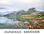 seven sisters  norway. mountain ... | Shutterstock . vector #668303308