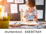 child  girl draws with colored... | Shutterstock . vector #668307664