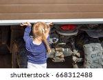 little blond girl opening... | Shutterstock . vector #668312488
