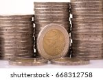 Small photo of large amount of two Euro money coins.