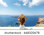 young woman enjoying view of... | Shutterstock . vector #668320678