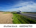 white truck driving on the road ... | Shutterstock . vector #668346703
