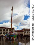 Small photo of LHASA,TIBET/CHINA-MAY 11: Jokhang Temple and prayers on May 11,2017 in Lhasa, Tibet, China. The temple is located on Barkhor Square in Lhasa, is Tibet first Buddhist temple