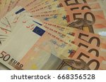 a stack of 50 euro banknotes ... | Shutterstock . vector #668356528