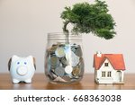 plant growing in savings coins  ...   Shutterstock . vector #668363038