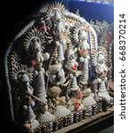 Small photo of Durga Maa made by conch shell. Colorful handcraft for interior decoration.