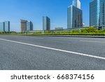 empty asphalt road front of...   Shutterstock . vector #668374156