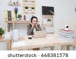young businesswoman uses a... | Shutterstock . vector #668381578