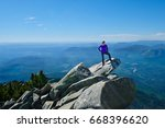 Woman middle age in victory pose on mountain top. Mount Pilchuck. Cascades Mountains. Seattle. Washington. United States.