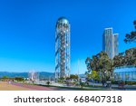 Small photo of Batumi, Georgia - April 30, 2017: Alphabetic Tower and Ferris wheel in Batumi, Georgia summer Black sea resort