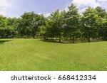 sunlight green lawn surrounded... | Shutterstock . vector #668412334