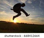 man on sunset   Shutterstock . vector #668412664