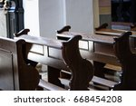 empty wooden benches in old ... | Shutterstock . vector #668454208