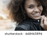 portrait of mixed raced girl in ... | Shutterstock . vector #668465896