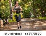 overweight woman running.... | Shutterstock . vector #668470510