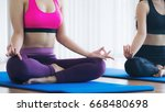 women doing yoga lotus pose ... | Shutterstock . vector #668480698