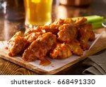 sauced buffalo chicken wings on ... | Shutterstock . vector #668491330