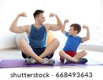 dad and son sitting on floor... | Shutterstock . vector #668493643
