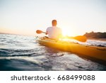 man kayaker paddling the kayak... | Shutterstock . vector #668499088