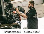 Motorcycle Mechanic Replacing...