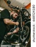 a professional mechanic... | Shutterstock . vector #668524180