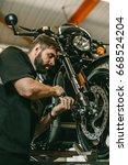 a professional mechanic... | Shutterstock . vector #668524204