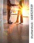 businesspeople shaking hands   Shutterstock . vector #668525539