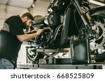 replacing the oil in a... | Shutterstock . vector #668525809