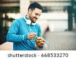 young handsome man is relaxing...   Shutterstock . vector #668533270